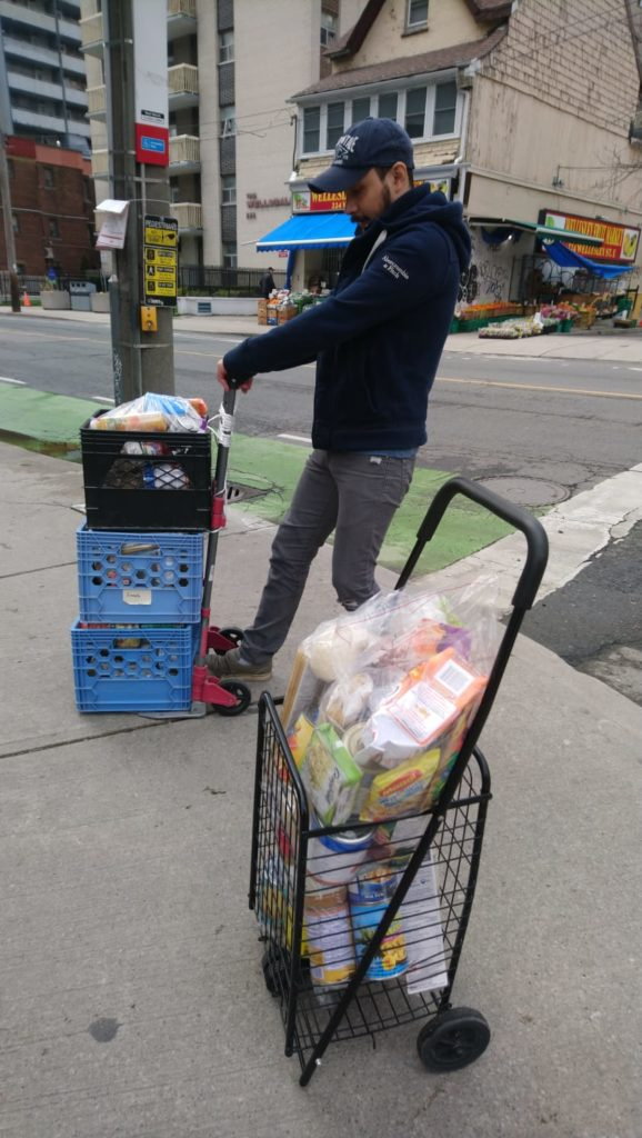 picture of a volunteer delivering donated groceries