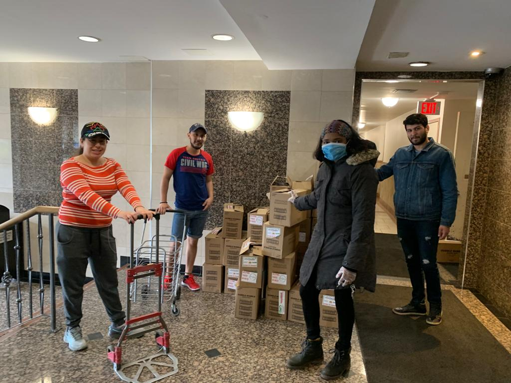 Picture of 4 volunteers delivering groceries